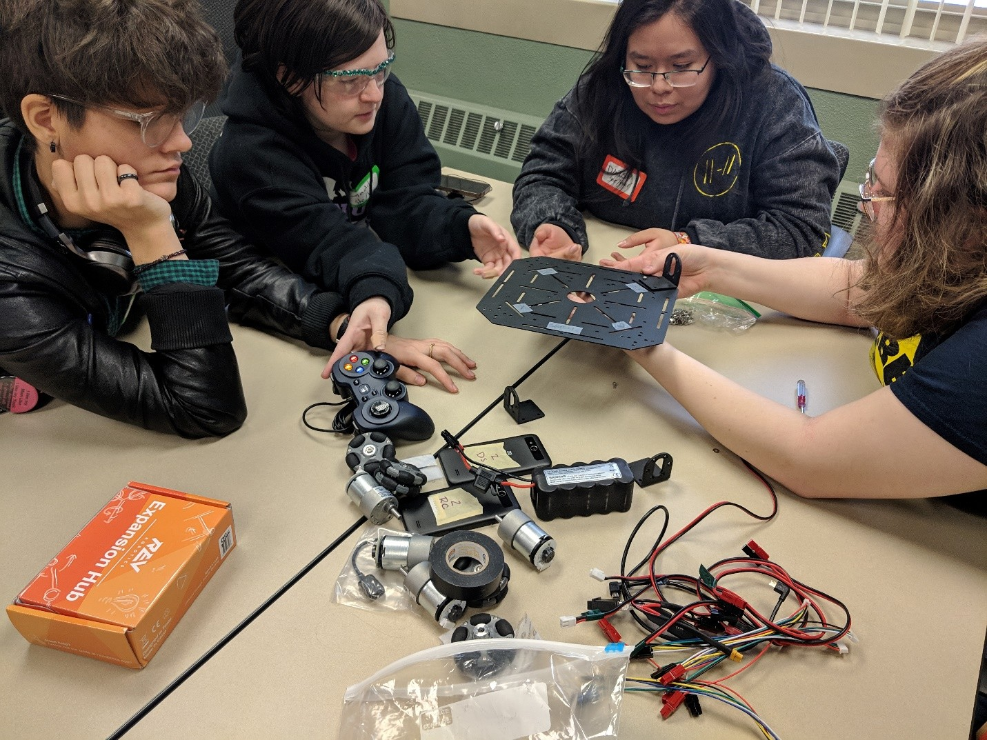 Students work together to build a robot